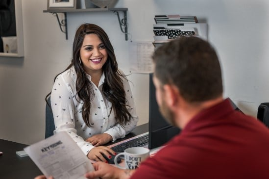 Female recruiter conducting job interview with male wearing red shirt at KP Staffing office